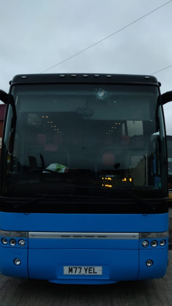 Yelloway M77YEL Coach in blue showing smashed windscreen