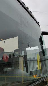 Smashed coach windscreen